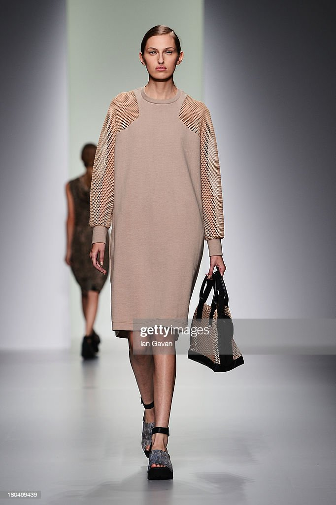 A detail is seen of a bag as a model walks the runway at the Christopher Raeburn show during London Fashion Week SS14 at BFC Courtyard Showspace on September 13, 2013 in London, England.