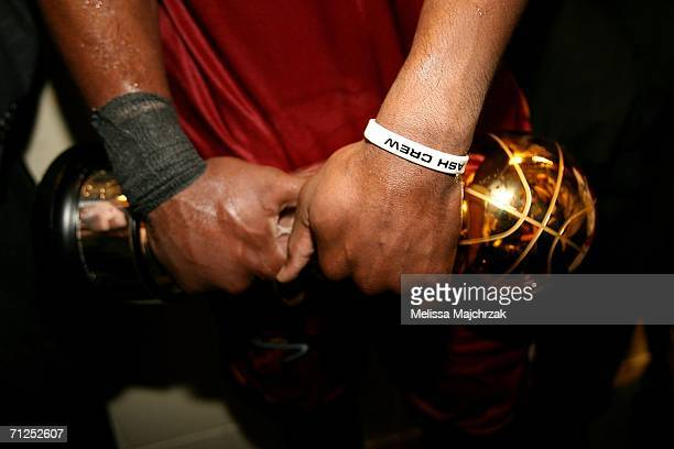 A detail is seen of finals MVP Dwyane Wade of the Miami Heat as he holds the MVP trophy while he is interviewed after the Heat won the NBA...