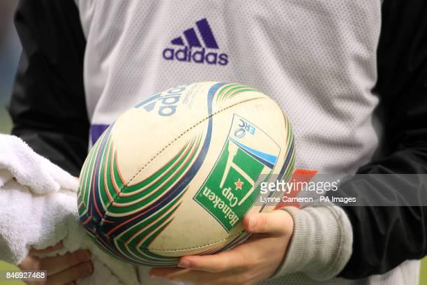 Detail of a ballboy holding an official Heineken Cup rugby matchball