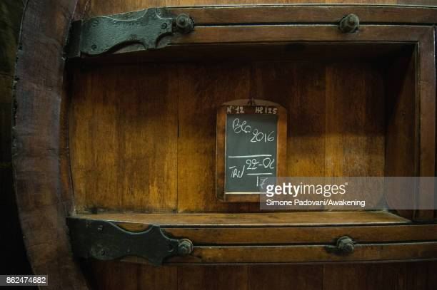 A detail of a barrel of a winery of Barolo on October 17 2017 in the Barolo region Italy Because of the high summer temperatures Barolo's harvest has...