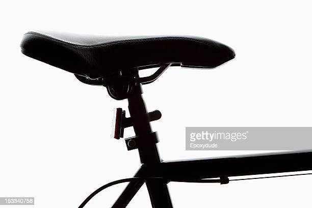 Detail of a bicycle seat, back lit, studio shot