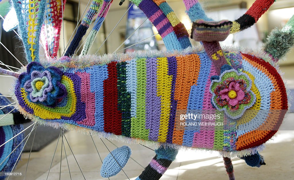 Detail of a bike completely coated in knitwear made by amateur artist Martha Schlothmann standing at the city hall of Neukirchen-Vluyn, western Germany, on August 29, 2012. Schlothmann was inpired by the urban street art during a trip to Venezuela and practices urban knitting now on different objects.