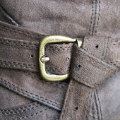 Detail of a buckle on a leather boot