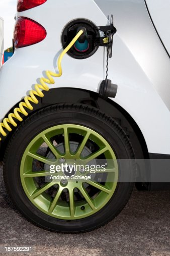 Detail of a charger connected to an electric car recharging