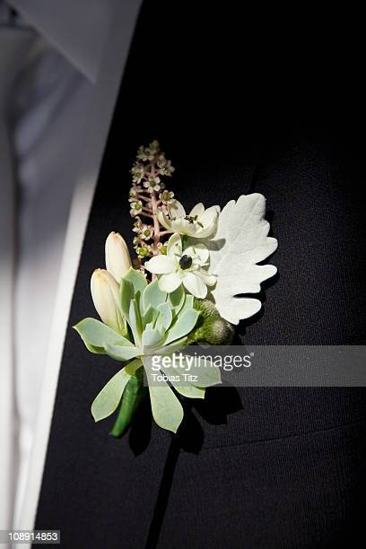 Detail of a corsage on the lapel of a man
