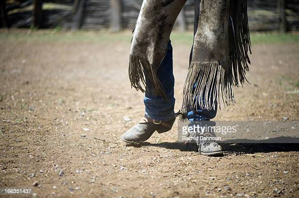 A detail of a cowboy's boots and chaps at the Ninety Six Ranch in Paradise Valley, NV.