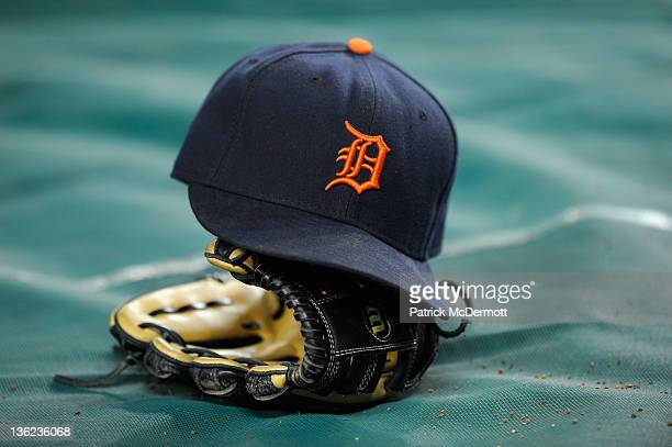 A detail of a Detroit Tigers hat and glove are seen during warm ups against the New York Yankees during Game Five of the American League Championship...