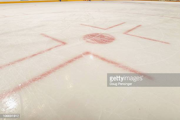 A detail of a face off circle as the ice sheet is prepared for the game as the Calgary Flames prepare to face the Colorado Avalanche at the Pepsi...