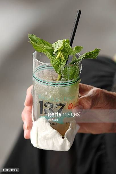 A detail of a fan holding a mint julep during the 137th Kentucky Derby at Churchill Downs on May 7 2011 in Louisville Kentucky