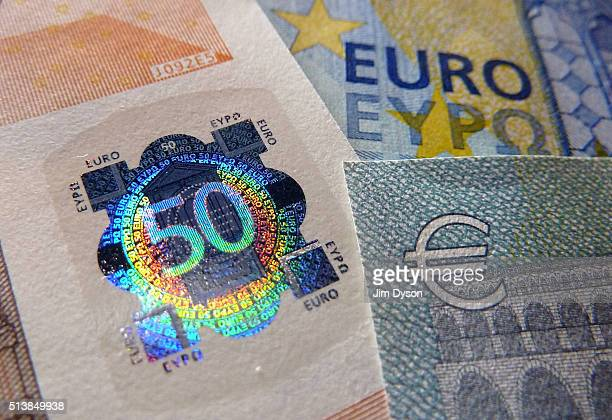 A detail of a fifty Euro bank note with hologram design on March 4 2016 in London England