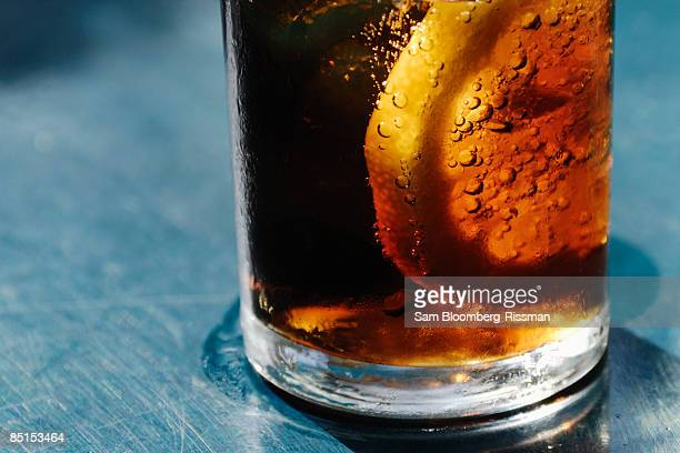 Detail of a glass with cola and a lemon
