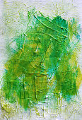 Abstract, green,yellow acrylics painted background texture.