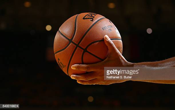 A detail of a hand holding a Spaulding basketball in Game Five of the 2016 NBA Finals between the Cleveland Cavaliers and Golden State Warriors on...