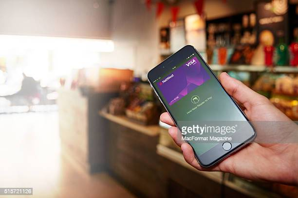 Detail of a hand holding an Apple iPhone 6S with the Apple Pay app visible onscreen on September 7 2015