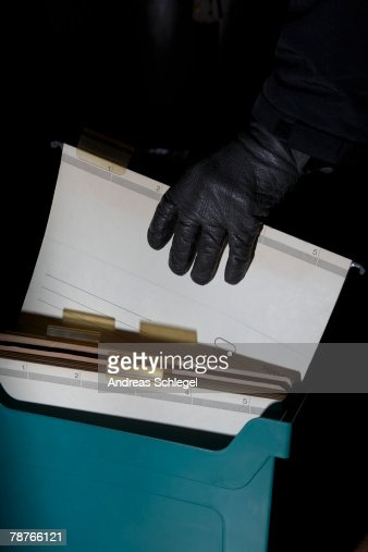 Detail of a hand with a leather glove holding a file