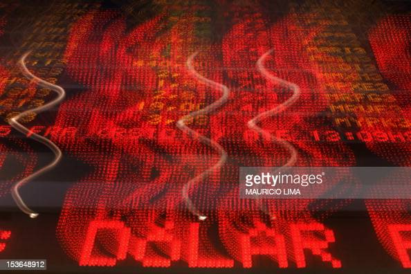 Detail of a headline reading 'Dollar' on an electronic board which presents the value of shares of Brazilian companies at the Sao Paulo Stock...