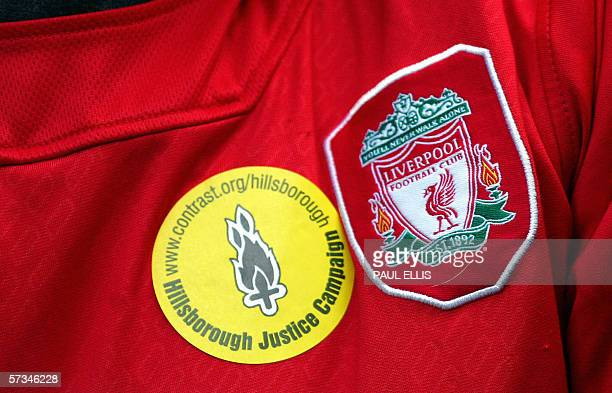 Detail of a jersey as Liverpool supporters stand for a minute of silence before their English Premiership soccer match against Blackburn Rovers at...
