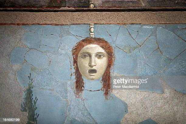 A detail of a large fresco at the Life And Death In Pompeii And Herculaneum exhibition shows the head of a decapitated woman at The British Museum on...