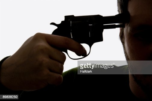 Detail of a man holding a gun to his head