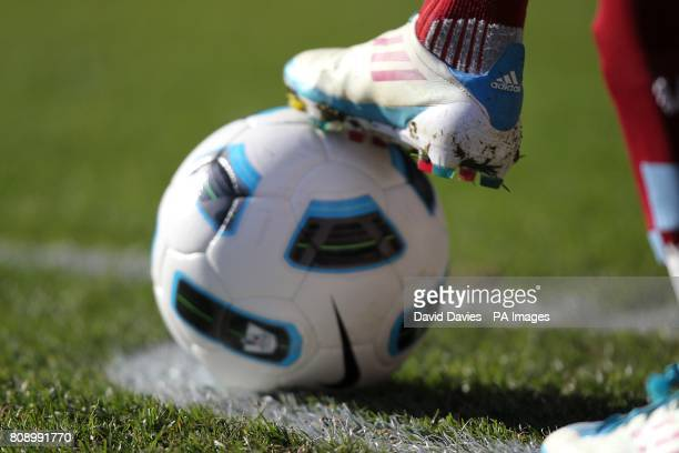 Detail of a matchball being controlled in the corner quadrant by an Aston Villa player sporting Adidas football boots
