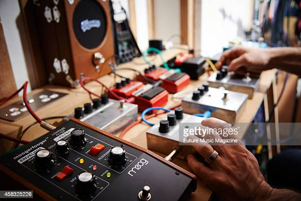 Detail of a musician creating samples with a variety of guitar effects pedals taken on April 11 2014