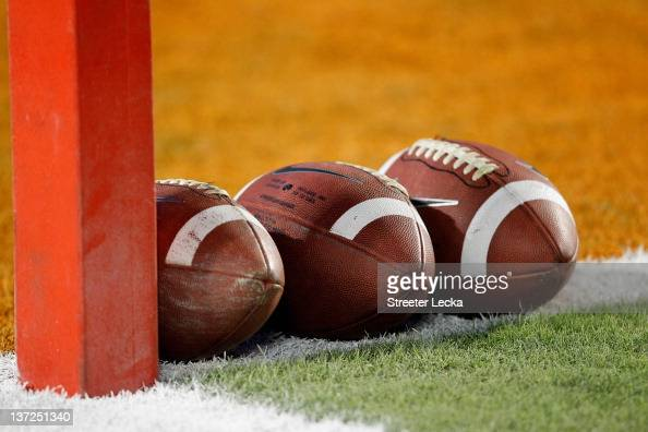 A detail of a Nike official NCAA size footballs as they sit in the end zone prior to the West Virginia Mountaineers playing against the Clemson...