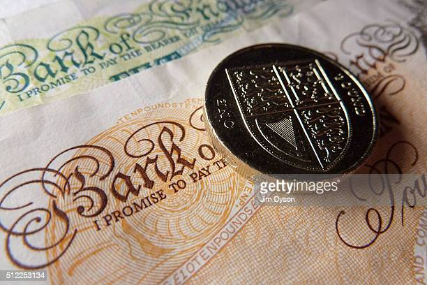 A detail of a one pound coin resting on a £5 and £10 banknote on February 24 2016 in London England The next range of banknotes will be printed on...