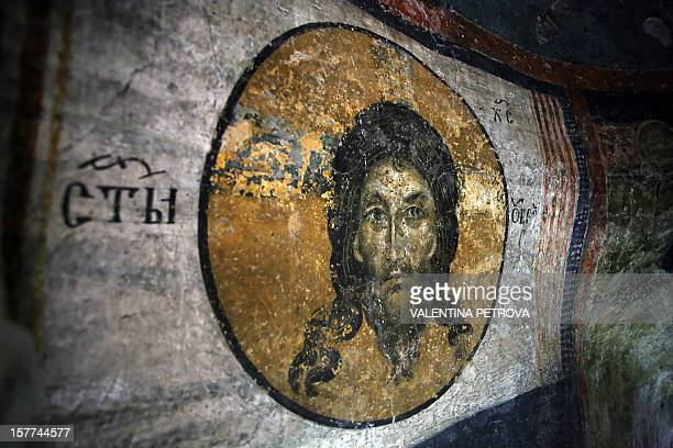 Detail of a part of the icon paintings showing the face of Jesus Christ in Boyana Church dated back to early 11th century and undergoing restoration...