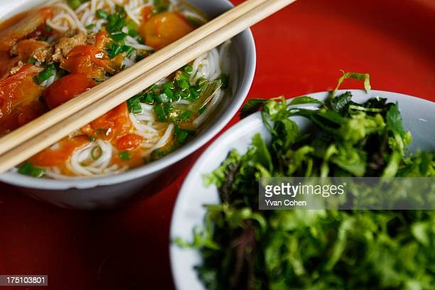 A detail of a pho noodle soup with freshly fried tofu on top at a street stall in downtown Hanoi Hanoi is Vietnam's administrative capital and the...