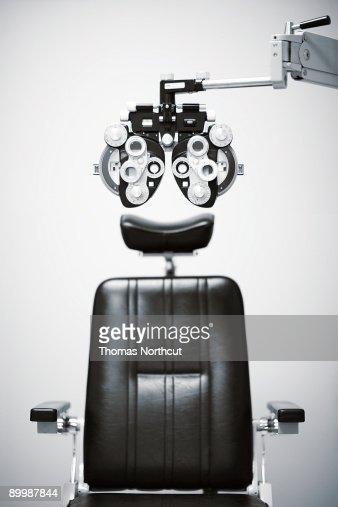 detail of a phoroptor with an exam chair : Stock Photo