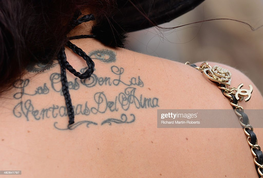 Detail of a racegoer's tattoo and Chanel handbag during Day 2, Ladies Day, of the Aintree Races at Aintree Racecourse on April 4, 2014 in Liverpool, England.