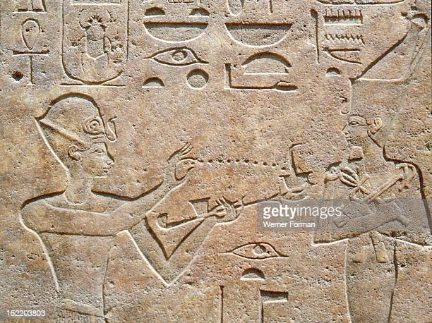 Detail of a relief showing Queen Hatshepsut burning incense to honour a god From the Red Chapel of Hatshepsut which was demolished by her successor...