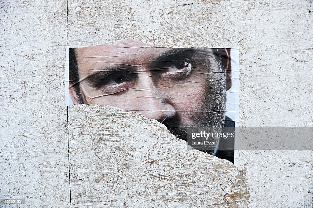 A detail of a ripped election poster shows the face of politician Antonio Ingroia on February 25, 2013 in Livorno, Italy. Italians have today headed to the polls for the second and final day of voting in Italy's general election. According to reports, early projections show Silvio Berlusconi's centre-right coalition slightly ahead of Pier Luigi Bersani's centre-left in Senate, contradicting exit polls.