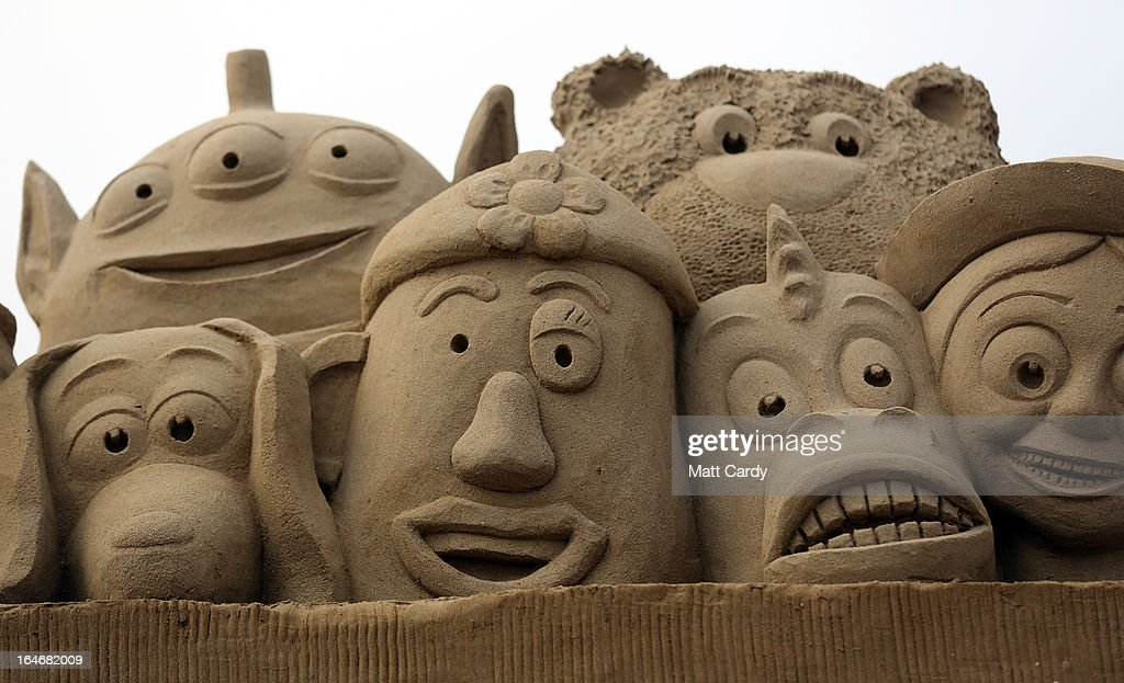 Detail of a sand sculpture of Toy Story is seen as pieces are prepared as part of this year's Hollywood themed annual Weston-super-Mare Sand Sculpture festival on March 26, 2013 in Weston-Super-Mare, England. Due to open on Good Friday, currently twenty award winning sand sculptors from across the globe are working to create sand sculptures including Harry Potter, Marilyn Monroe and characters from the Star Wars films as part of the town's very own movie themed festival on the beach.