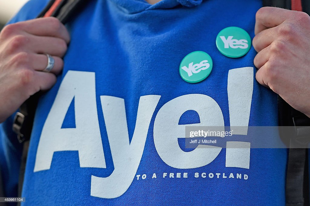 A detail of a shirt with the words 'Aye' as Independence supporters including Blair Jenkins and the Proclaimers attend an announcement to mark getting a million signatures to the Yes Declaration launched in 2012 on August 22, 2014 in Edinburgh, Scotland. Both camps in the referendum campaign are holding events on the first day of purdah, a 28 day period which curbs what public bodies can do during the election period.