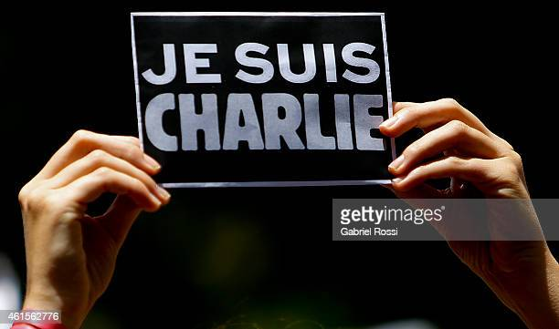 Detail of a sign with the words 'Je sui Charlie' during a tribute to the 17 victims of this week's Islamists militant attacks in France at Embassy of...