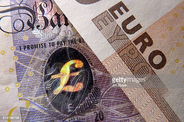 A detail of a twenty Pound bank note with hologram design and a fifty Euro note on March 7 2016 in London England