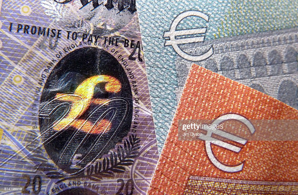 A detail of a twenty Pound bank note with hologram design and a five and ten Euro note on March 7 2016 in London England