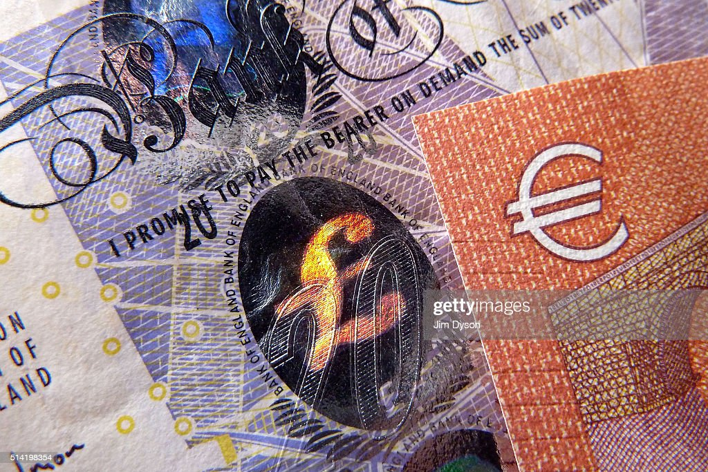 A detail of a twenty Pound bank note with with hologram design and a ten Euro note on March 7 2016 in London England