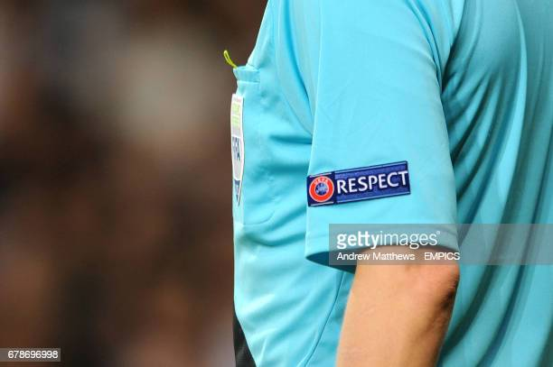 Detail of a UEFA Respect campaign badge on the shirt sleeve of a Champions League official