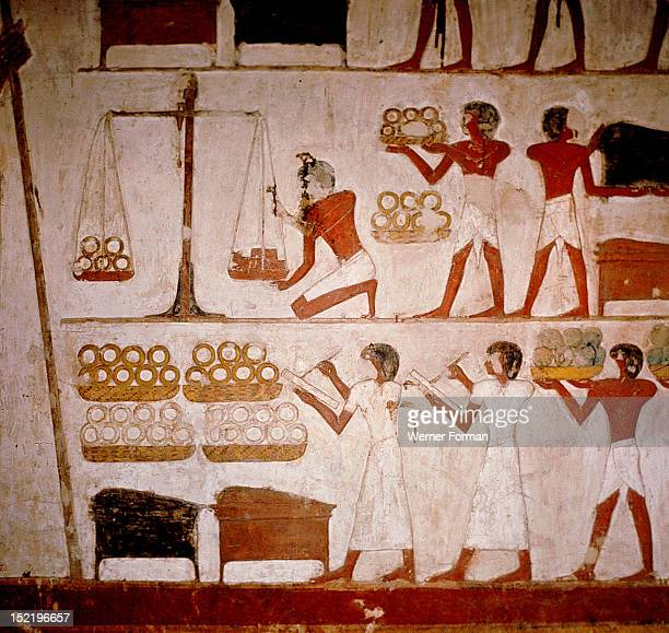 A detail of a wall painting in the tomb of Panekhmen depicting metal workers weighing gold on scales Egypt Ancient Egyptian 19th dynasty c 1295 1186...