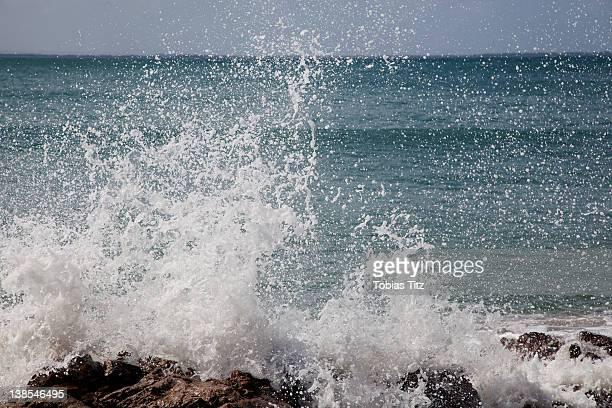 Detail of a wave splashing on rocks