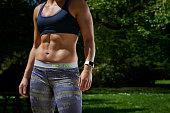 Detail of a woman in sportswear modelling an Apple Watch Sport taken on May 21 2015