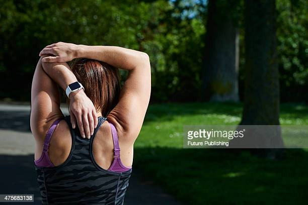 Detail of a woman in sportswear stretching while modelling an Apple Watch Sport taken on May 21 2015