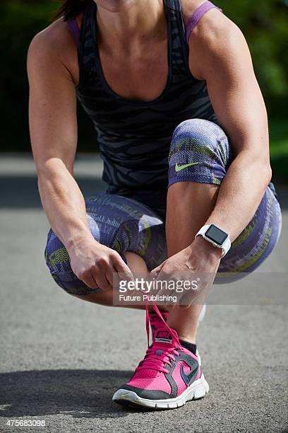 Detail of a woman in sportswear tying a shoelace while wearing an Apple Watch Sport taken on May 21 2015