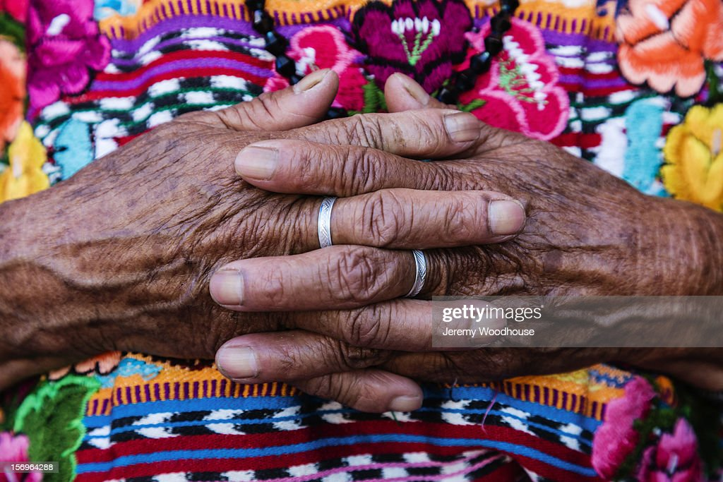 Detail of a woman's hands ana dtraditional dress