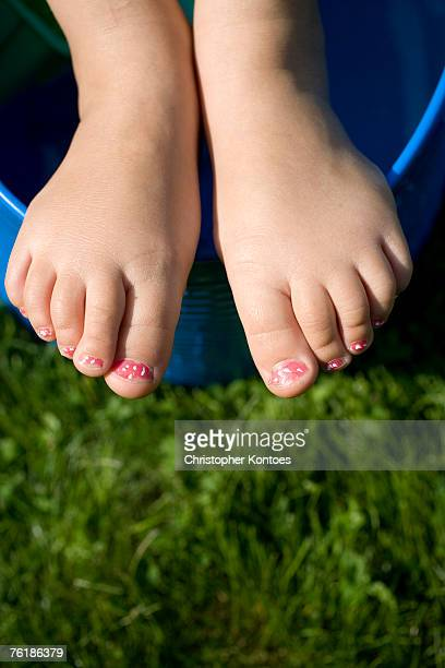 Detail of a young girls feet with painted toenails