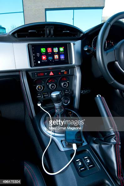 Detail of an Apple iPhone 5 and Pioneer head unit fitted in a Subaru BRZ photographed for a feature on Apple's CarPlay taken on December 19 2014