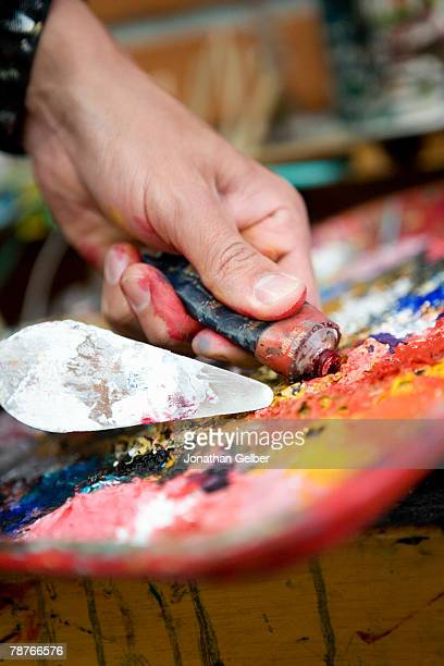 Detail of an artist mixing paint