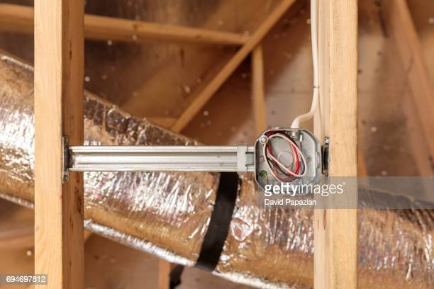 Detail of an electrical outlet with hvac duct